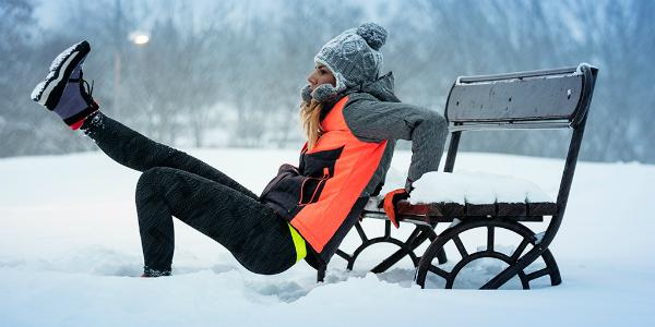 Girl exercising in snow
