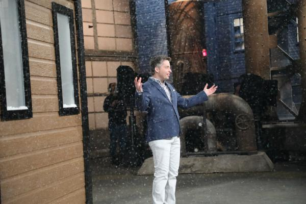 Snow falling on man during audition at Dragons Den - telescopic roof rake episode